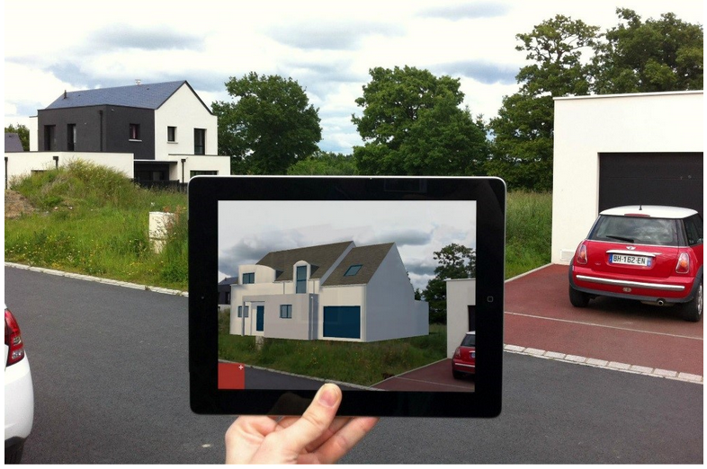 La maison apparai^t en suimpression dans la rue grâce à la réalité augmentée